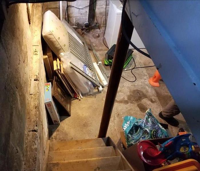 Water damage in a basement due to heavy rains