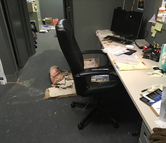 Water damage caused from a roof leak in an office