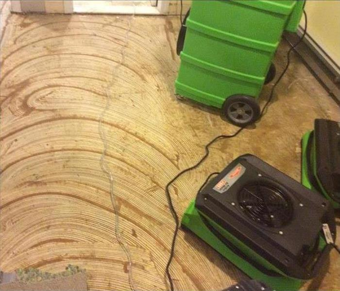 Two air movers placed on the floor